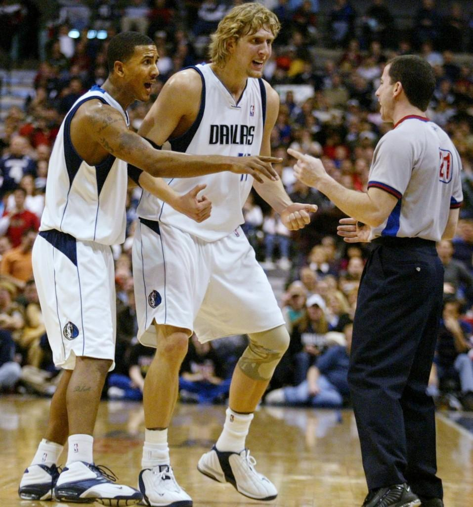 Referee Tim Donaghy does not back down from Dallas Mavericks' Dirk Nowitzki and Raja Bell in his quest to make a few dollars on the side. (Louis Deluca/MCT)