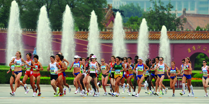 Runners compete in the Olympic Women's Marathon in Beijing, in 2008. Women did not have an Olympic Marathon event until 1981. (Joe Rimkus, Jr/Miami Herald/MCT)