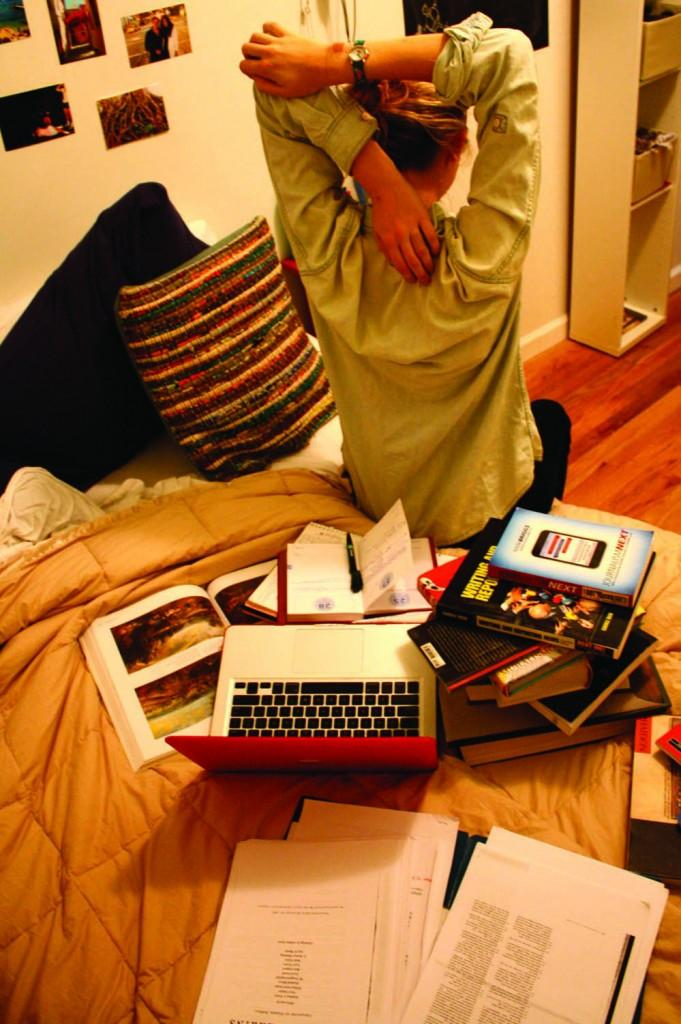 Take a break from the all-nighter to stretch. It can keep you relaxed and focused during long study sessions. (Katherine Fotinos/The Observer)