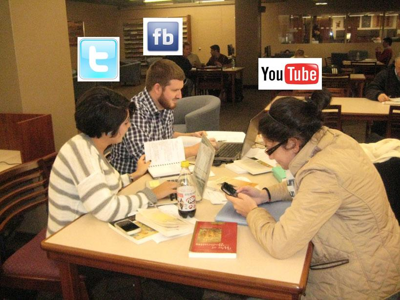 Students+in+the+library+use+their+laptops+and+cellular+phones+to+check+Facebook%2C+YouTube+and+Twitter.+%28Photo+Illustration+by+Fatima+Shabbir%2FThe+Observer+%29