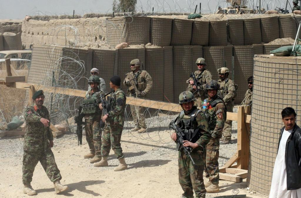 U.S. soldiers posted in Afghanistan stand guard alongside their unit. More graphic photos published recently in the L.A. Times have stirred controversy among readers. (Jon Stephenson/MCT)