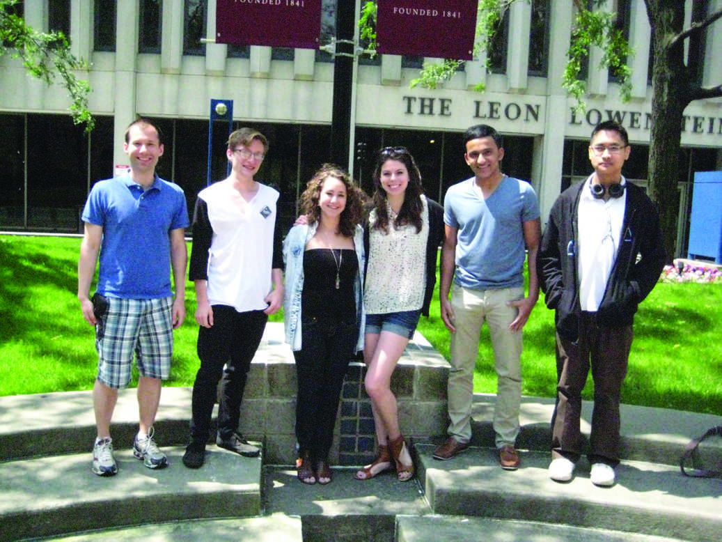 The recipients of the 2012 Summer Research Grants pose on the Outdoor Plaza. The grants helped them expand their studies outside of Fordham. (Photo Courtesy of John Wu)