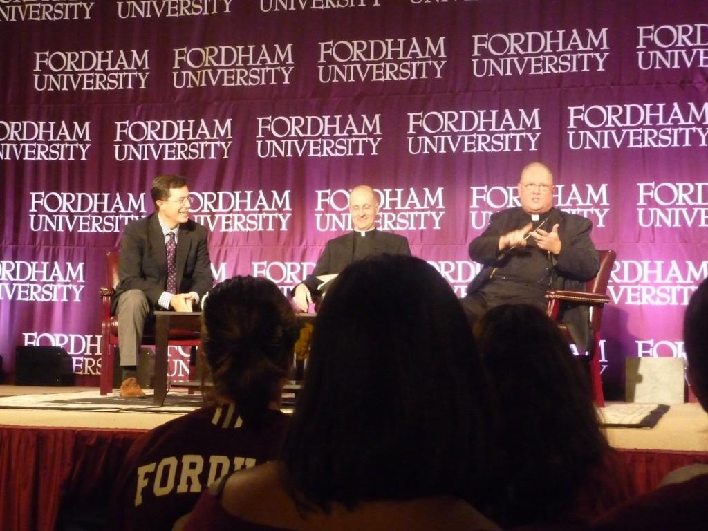 "From left, Stephen Colbert of ""The Colbert Report,"" Father James Martin S.J. and Timothy Cardinal Dolan discuss Catholicism and humor in front of  more than 3,000 students in the Rose Hill Gymnasium on Sept. 14. Fordham tried to enforce a media blackout for the event. (Brian Bruegge/The Observer)"