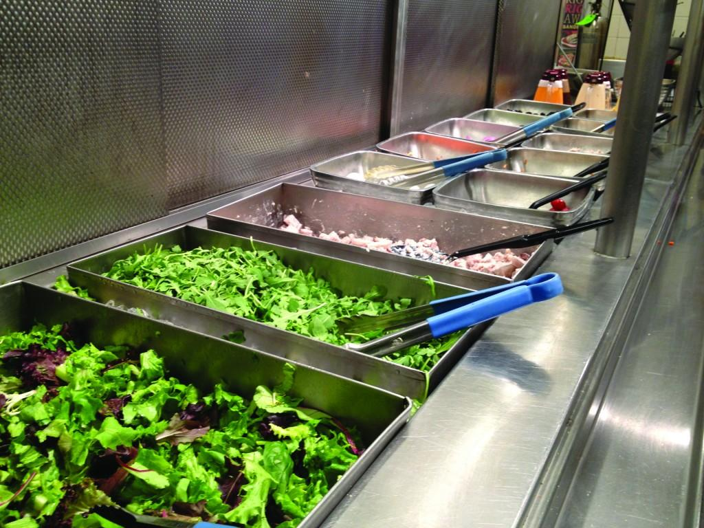 Add chickpeas to a bed of arugula at the Ram Café salad bar for a meal packed with calcium and protein. (Rex Sakamoto/The Observer)