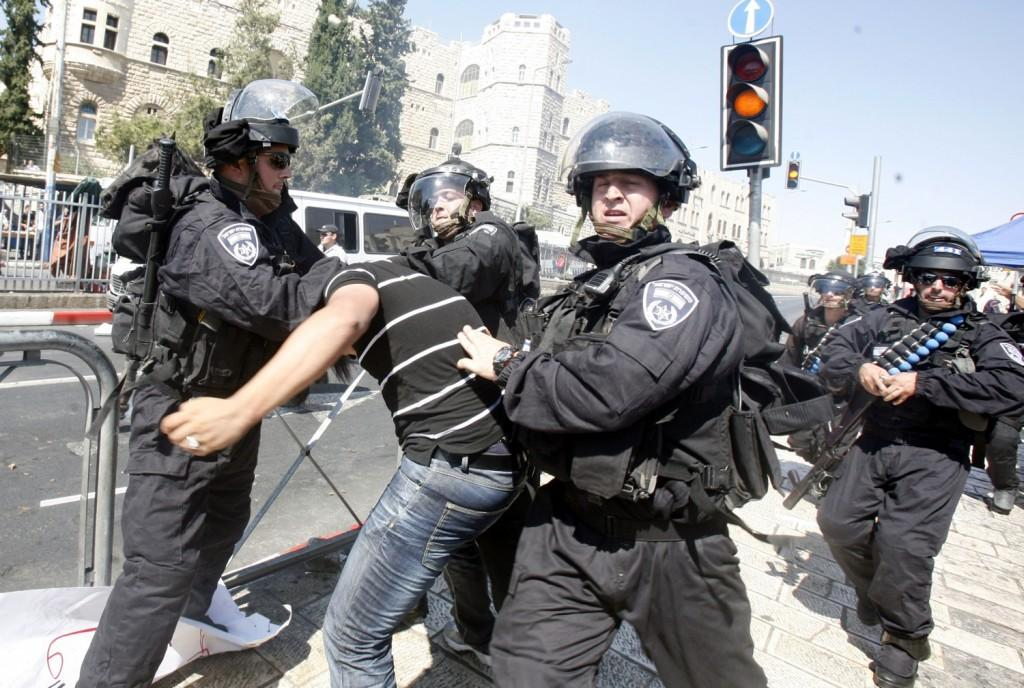 "Outside the al-Aqsa Mosque in Jerusalem, a Palestinian man protesting the film ""Innocence of Muslims"" is being arrested by Israeli policemen.  