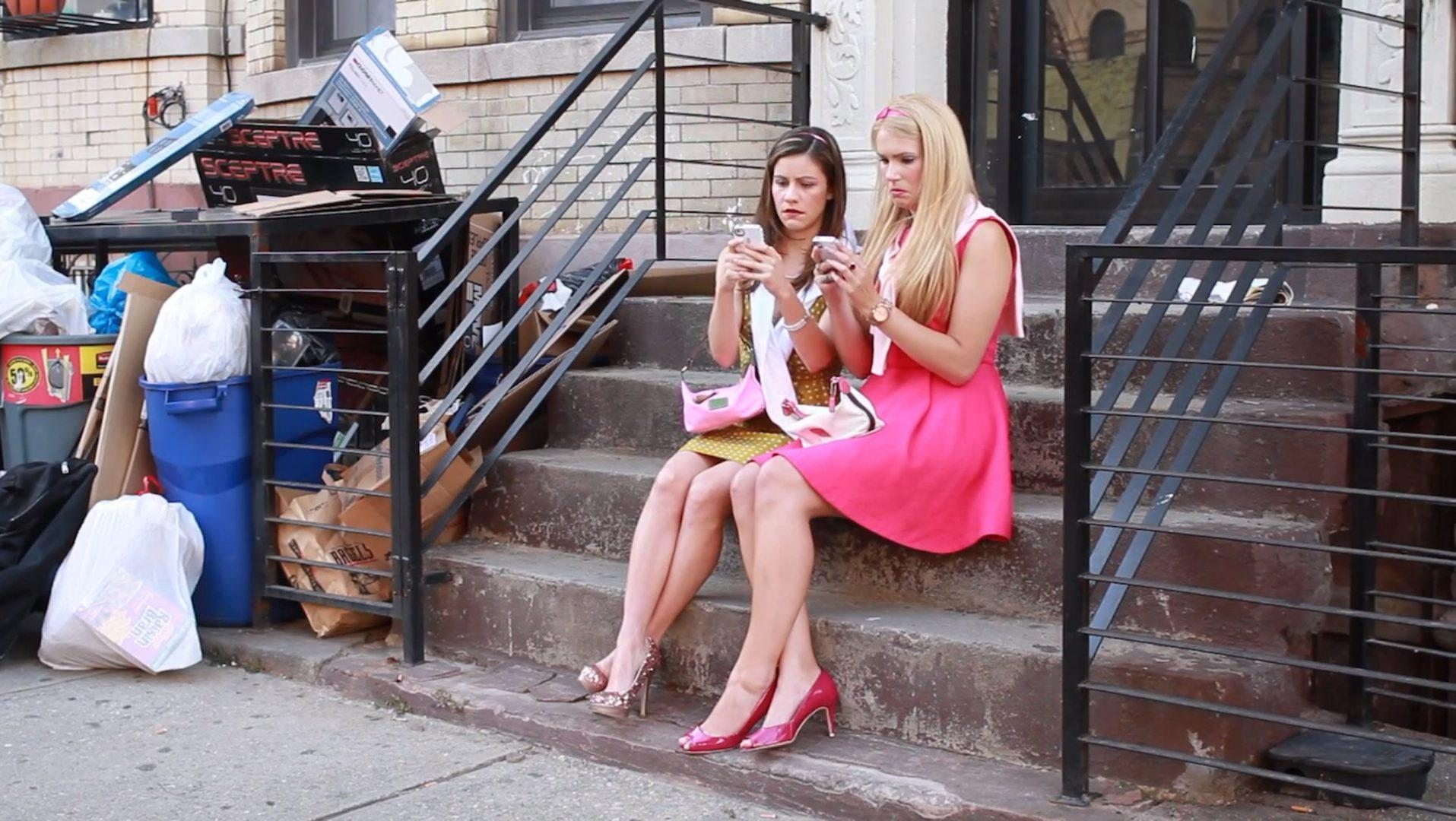 "Emily Tarpey (left) and Leena Borst (right) in a scene from ""Gentrified,"" their comedic web series that follows the adventures of two girls through the boroughs of New York City. (gentrifiedthewebseries/youtube.com)"