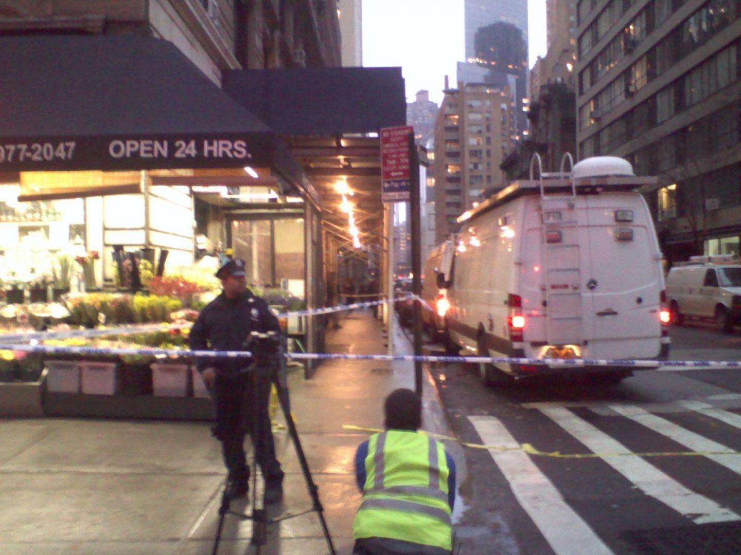 Police cordoned off the block of 58th Street between Broadway and 7th Avenue after a man was shot and killed at 2 p.m. Monday. (Mike Madden/The Observer)