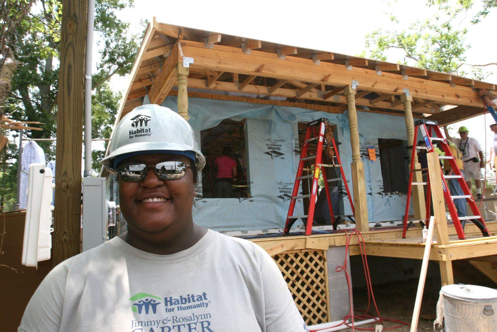 Angel Lewis stands in front of the new home being built by volunteers during Habitat for Humanity's Jimmy & Rosalynn Carter Work Project in the Forest Heights subdivision in Gulfport, Mississippi, Tuesday, May 13, 2008. (James Edward Bates/Biloxi Sun-Herald/MCT)
