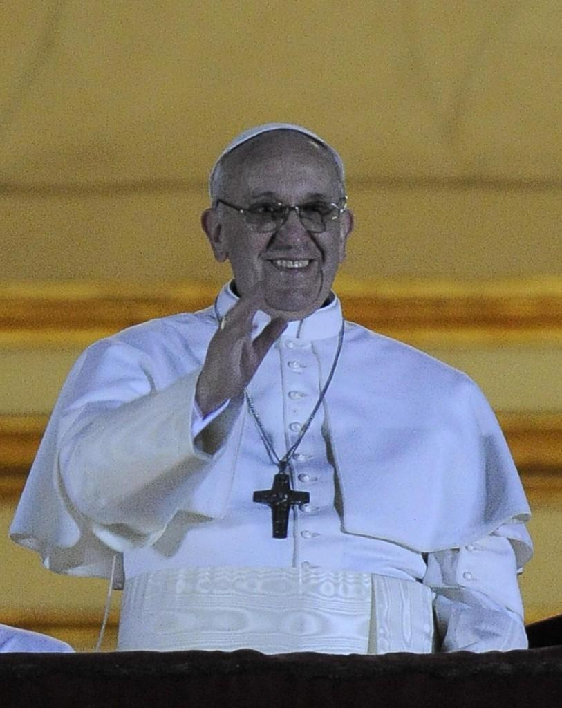 Newly elected Pope Francis I addresses a crowd at the middle balcony of St. Peter's Basilica. (Maurizio Brambatti/Ansa/Zuma Press/MCT)