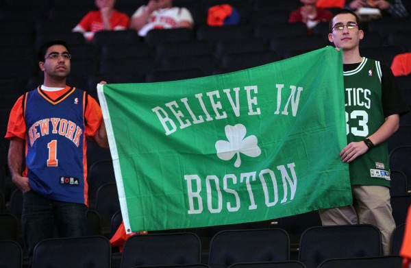 A New York Knicks and Boston Celtics fan hold up a sign on Saturday, April 20, 2013, to pay tribute to the victims of the Boston Marathon. The Boston Celtics faced the New York Knicks in the NBAs Eastern Conference playoffs in New York, New York. (Matt Stone/Boston Herald/MCT)
