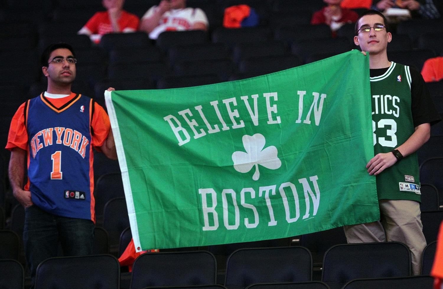 A New York Knicks and Boston Celtics fan hold up a sign on Saturday, April 20, 2013, to pay tribute to the victims of the Boston Marathon. The Boston Celtics faced the New York Knicks in the NBA's Eastern Conference playoffs in New York, New York. (Matt Stone/Boston Herald/MCT)