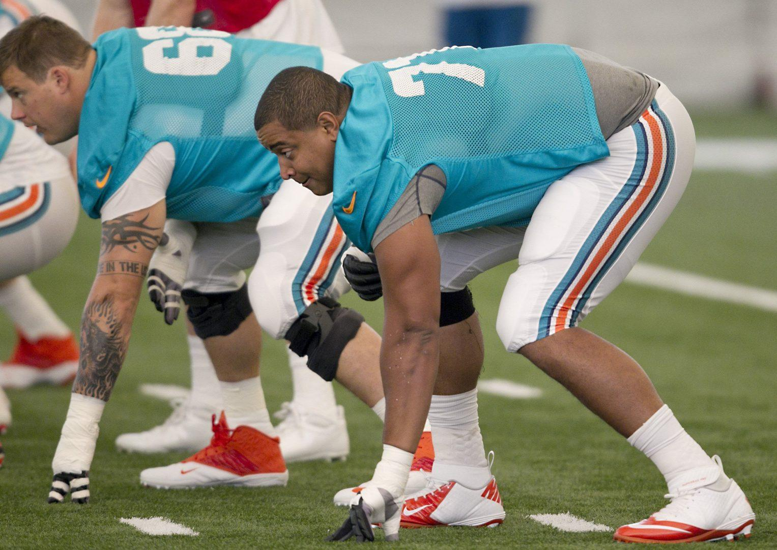 Offensive tackle Jonathan Martin has left the Miami Dolphins due to bullying within the locker room. (Joe Rimkus Jr/Miami Herald via MCT)