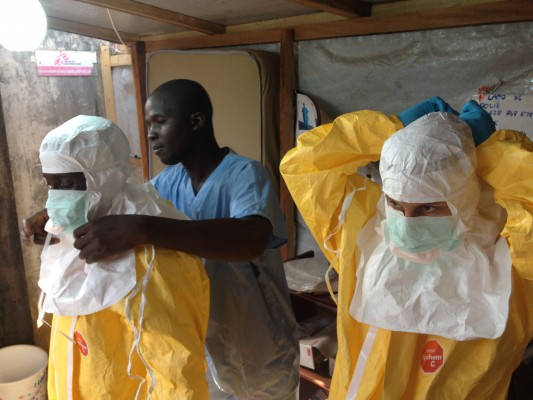 Aid workers prepare for contact with a diagnosed Ebola case in Guinea. (courtesy European Commission DG ECHO via Flickr)