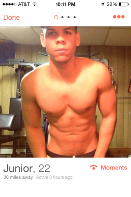 No smile and a hat on his head? What on Earth could he be hiding? (Photo Courtesy of Tinder)
