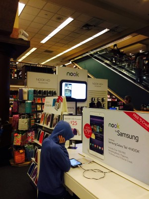 Barnes & Noble shoppers contemplate whether to buy their books in print or to invest in an e-reader. (Lauren Macdonald/The Observer)