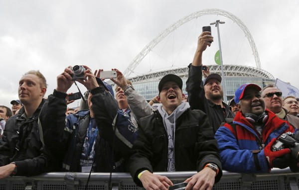 Fans cheer as the Dallas Cowboys are introduced on stage during an NFL All Access fan event on Saturday, Nov. 8, 2014, at Wembley Stadium in London. (Rodger Mallison / Fort Worth Star-Telegram/MCT)