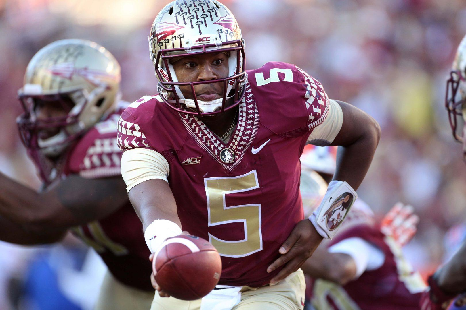 Florida State quarterback Jameis Winston (5) hands off during the second half against Florida at Doak Campbell Stadium in Tallahassee, Fla., on Saturday, Nov. 29, 2014. Florida State won, 24-19. (Joe Burbank / Orlando Sentinel/TNS)