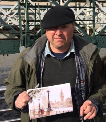 Jacque with one of his paintings on the Jubilee Bridge. (PHOTO COURTESY OF LEIGHTON SCHNEIDER)