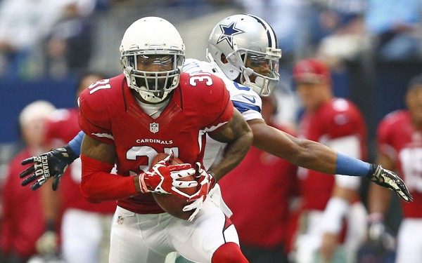 Arizona Cardinals cornerback Antonio Cromartie (31) intercepts the ball in front of Dallas Cowboys wide receiver Terrance Williams (83) during the fourth quarter on Sunday, Nov. 2, 2014, at AT&T Stadium in Arlington, Texas. (Ron Jenkins/Fort Worth Star-Telegram/MCT)