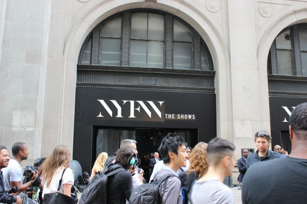 Madness ensues as the NYFW location is changed to the skylight at Moynihan Station. A crowd of people rush in to see the Project Runway show on September 11, 2015. (Photograph by Zana Najjar/The Observer)