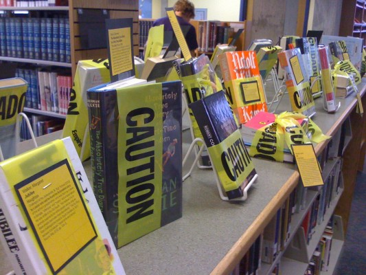 Banned books were wrapped in caution tape. (Courtesy of covs97 via Flickr)