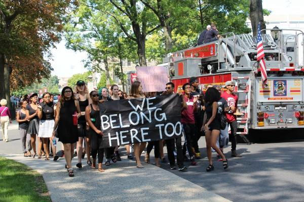 The group of students marched down Constitution Row, the road intersecting Coffey Field and the homecoming tent set up on Edward's Parade (CONNOR MANNION/THE OBSERVER)