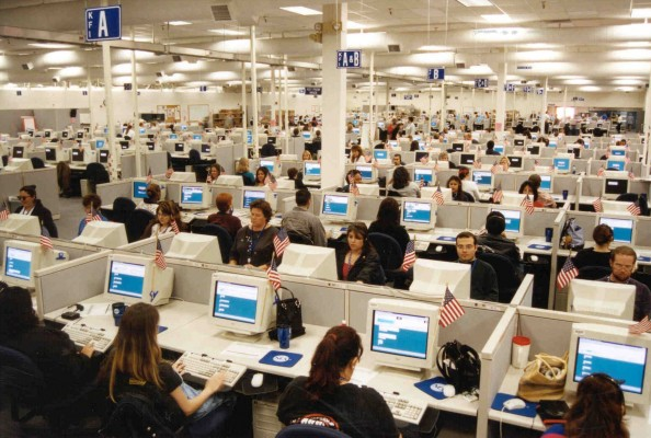Workers at the Phoenix Data Capture Center use computers to input census data. The computers read handwritten forms correctly more than 99.4 percent of the time. Technology has improved the accuracy and speed of tabulating the population of the country. (PHOTO BY U.S. CENSUS BUREAU VIA PHILADELPHIA INQUIRER VIA TNS)