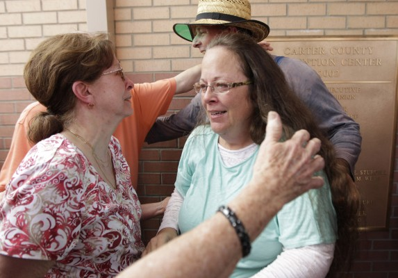 Kim Davis, center, and husband Joe Davis are greeted by relatives, including Kim's mother Jean Bailey, left, outside the Carter County Detention Center in Grayson, Ky., on Tuesday, Sept. 8, 2015. (Pablo Alcala/Lexington Herald-Leader/TNS)