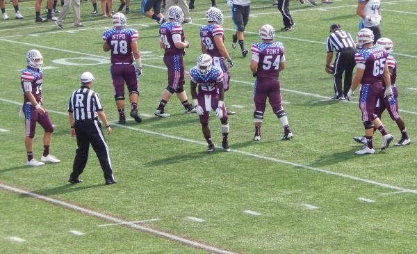 Fordham football players prepare for the next play. (LYDIA BENNER/ THE OBSERVER)