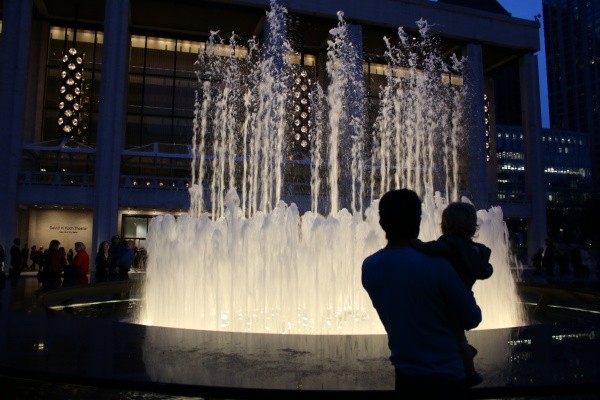 A father and son pause to enjoy the beauty of Lincoln Center at night. (PHOTO BY JULIA CORNELL/ THE OBSERVER)