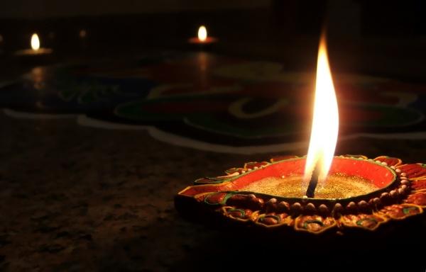 A diya is lit on Diwali, celebrating the victory of light over darkness (Abhinaba Basu via Flickr)
