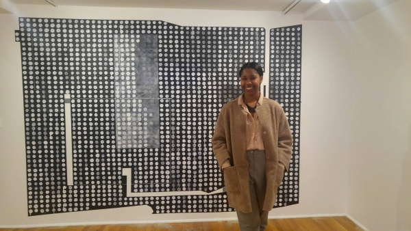 Isoke-Nilaja Cullins stands in front of an art piece at Studio Museum in Harlem, where she works as in intern in the public relations department. (PAOLA JOAQUIN ROSSO/THE OBSERVER)