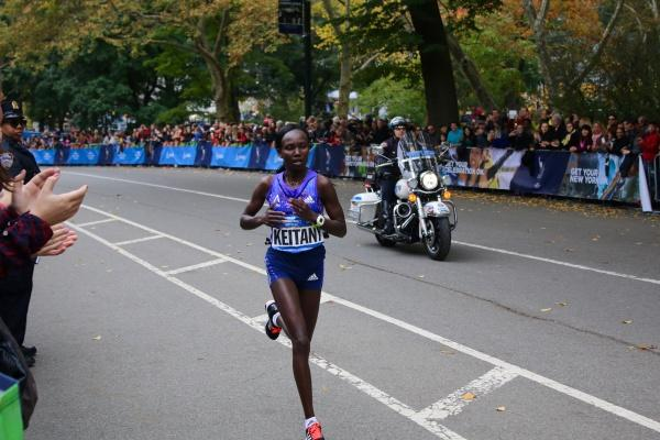 Winner+of+the+New+York+City+Marathon+two+years+in+a+row%2C+Mary+Keitany+of+Kenya++approaches+the+final+mile+with+a+glimmer+of+triumph+in+her+eyes.+%28PHOTO+BY+JULIA+CORNELL+%2F+THE+OBSERVER%29