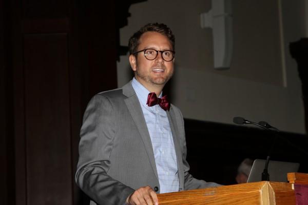Dean Joseph Desciak donning a bow tie and suit jacket during a lecture (COURTESY OF DEAN DESCIAK)