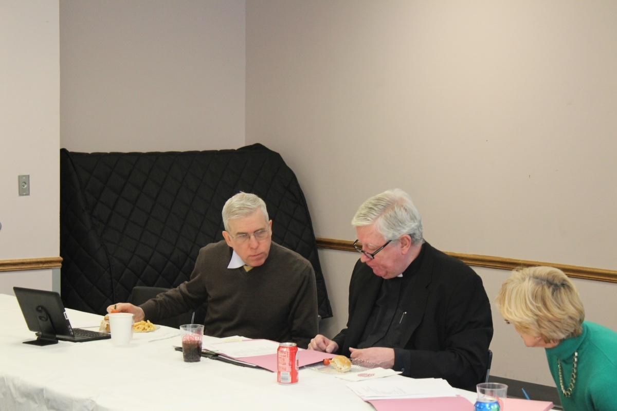 Robert Grimes (center) led the discussion with news of what was going on at Fordham (CONNOR MANNION/THE OBSERVER)