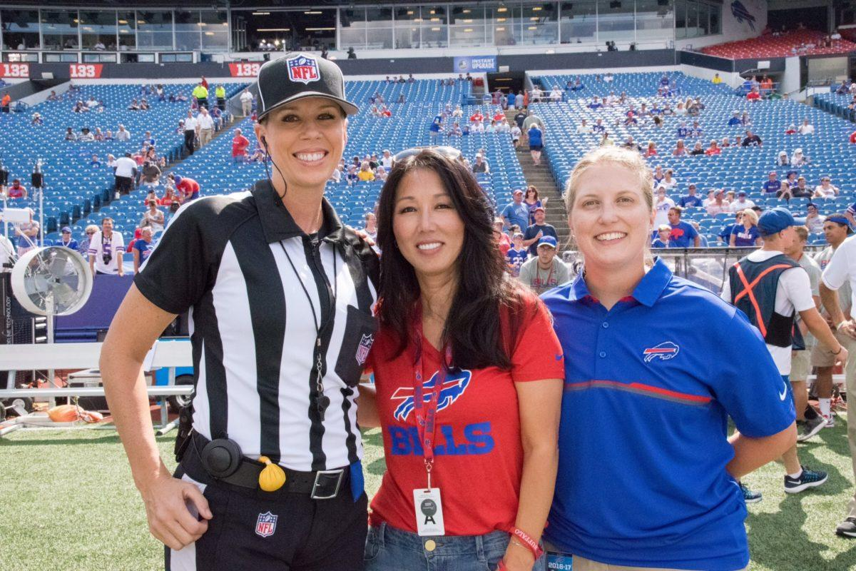 Kathyrn Smith (right) pictured with referee Sarah Thomas and Bills owner Kim Pegula before their historic game in August. (COURTESY OF KIM PEGULA/TWITTER)