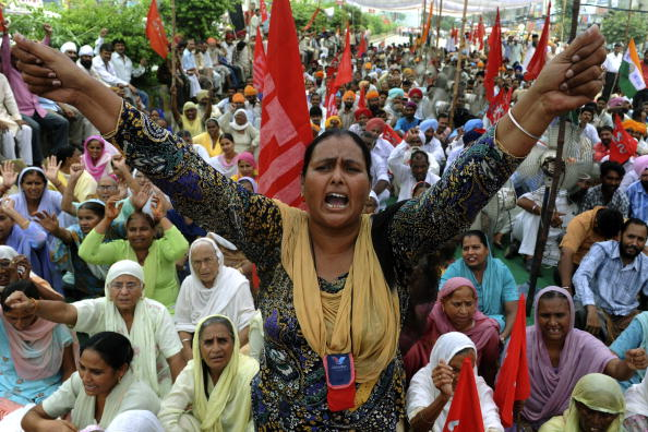 Communist Party of India (Marxist) (CPI-M) supporters along with trade unionists shout slogans and wave flags during a protest rally in Amritsar on September 7, 2010, part of a nationwide strike. A strike called by trade unions and left parties in India to protest against rising prices and alleged anti-labour policies crippled life in the country.   AFP PHOTO/NARINDER NANU (Photo credit should read NARINDER NANU/AFP/Getty Images)