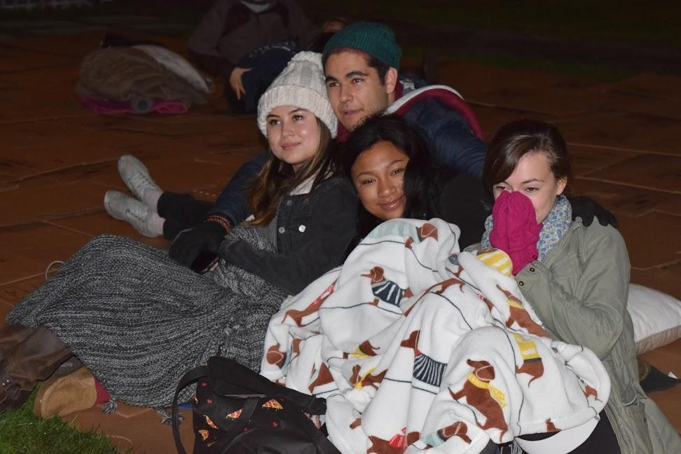 Students bundle up on mats of cardboard to sleep overnight on the plaza. (JON BJORNSON JR/THE FORDHAM OBSERVER)