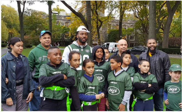 Members of the Bronx Community Board 6 organized an event with PAL participants and the New York Jets on Martyrs' Lawn. (PHOTO COURTESY OF BRONX COMMUNITY BOARD 6)