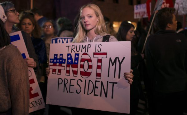 A young woman protests the presidential victory of Donald J. Trump on Nov. 9.  (PHOTO COURTESY OF FIBONNACCI BLUE VIA FLICKR)