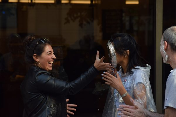 Olivia LaBarge throws a pie in a volunteer's face for charity. (SAMUEL MCHALE/THE OBSERVER)