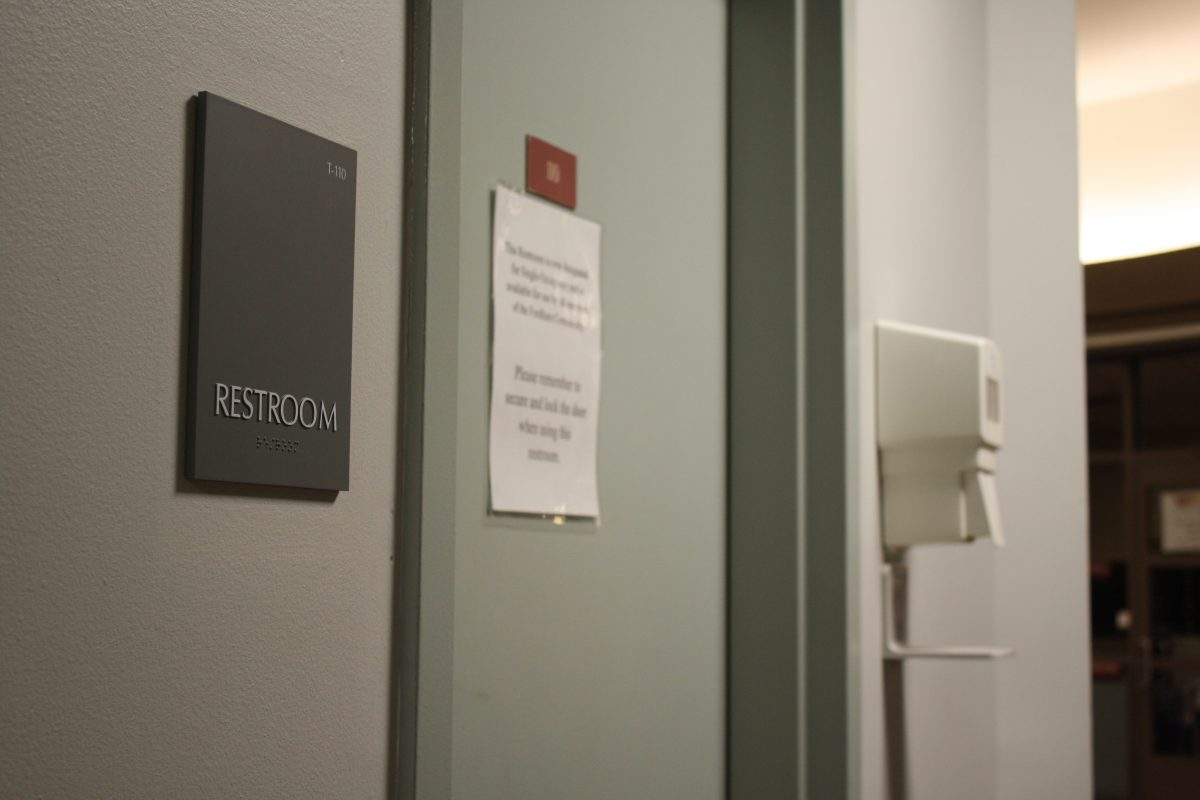 "Signage of bathroom located near the lobby of McMahon Hall was changed to just say ""Restroom"" in 2017. (ASEAH KHAN/THE OBSERVER)"