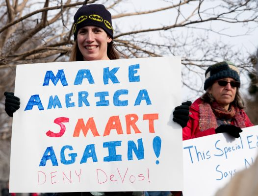 Protestors have been demonstrating against the appointment of DeVos. (VICTORIA PICKERING / FLICKR)