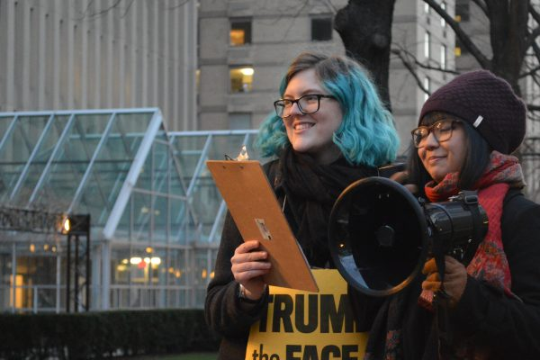 Sapphira Lurie, left, at a protest of the travel ban in January. Elizabeth Landry/The Observer