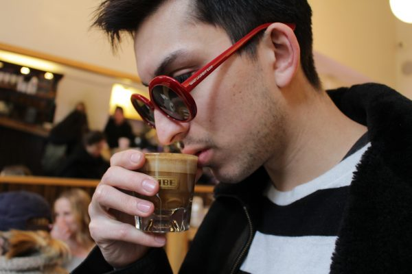 Marc Deitz (FCLC '18) drinks a cup of coffee before class on February 6, 2017 in Soho, NYC. (ASEAH KHAN/THE OBSERVER).