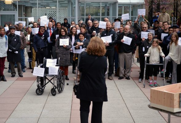 Professor Micki McGee addresses the crowd at the faculty sick-in protest on April 19. (ELIZABETH LANDRY/The Observer)