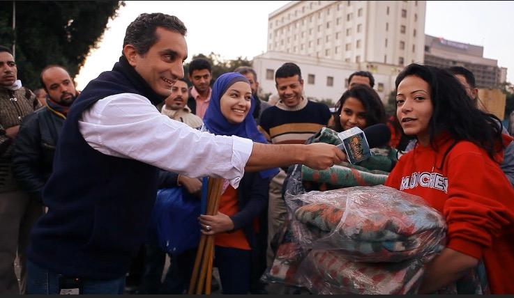 Bassem interviewing people at  Mohamed Mahmoud Street in November 2011. (PHOTO COURTESY OF SARA TAKSLER)