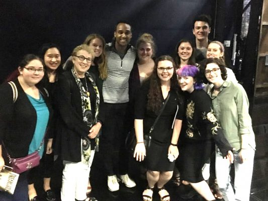 Joe Aaron Reid (center) poses  with our class backstage at