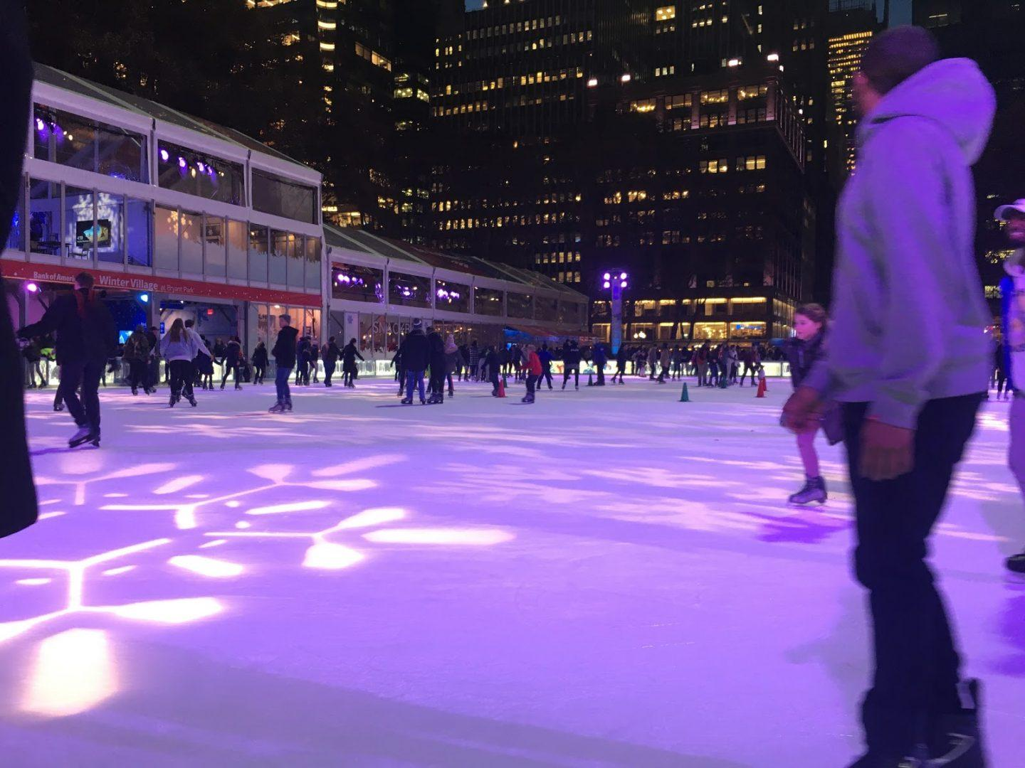 Skaters relax at the ice rink at Bryant Park. (COURTNEY BROGLE/THE OBSERVER)