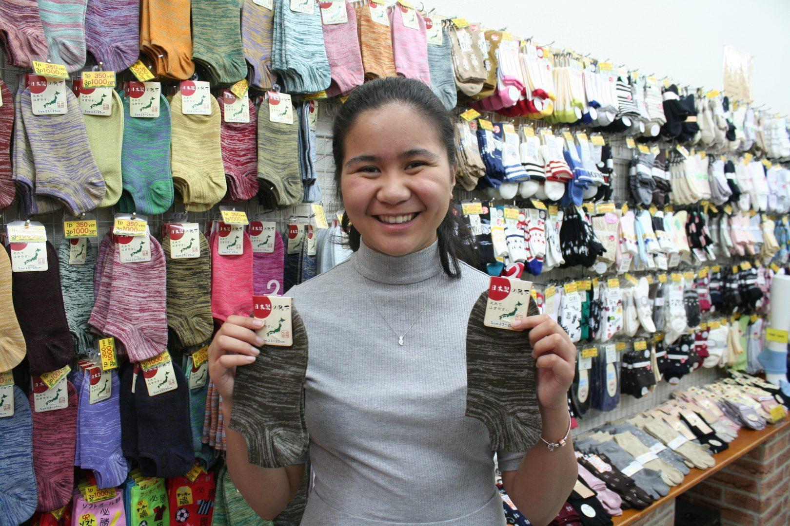 """Student Gives Out """"Socks in the City"""""""
